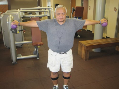Joe Sanchez performing arm exercises in the gym