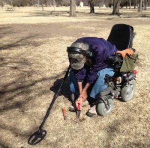 Metal detecting, power chair, trowel, digging, Jerry King