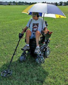 Metal detecting, power chair, umbrella